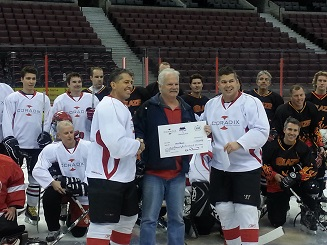President Tony Carmanico (left) and Business Intelligence Practice Lead, Donald Richard (right) present $1500 cheque